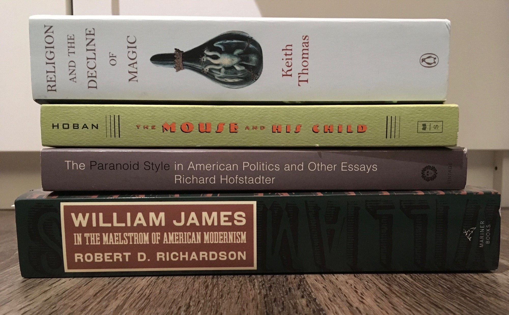 The spines of four books - Thomas: Religion and the Decline of Magic; Hoban: The Mouse and His Child; Hofstadter: The Paranoid Style in American Politics; Richardson: William James, In the Maelstrom of American Modernism