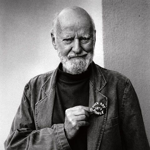 Lawrence Ferlinghetti with a pin on his lapel that reads: fuck art lets dance