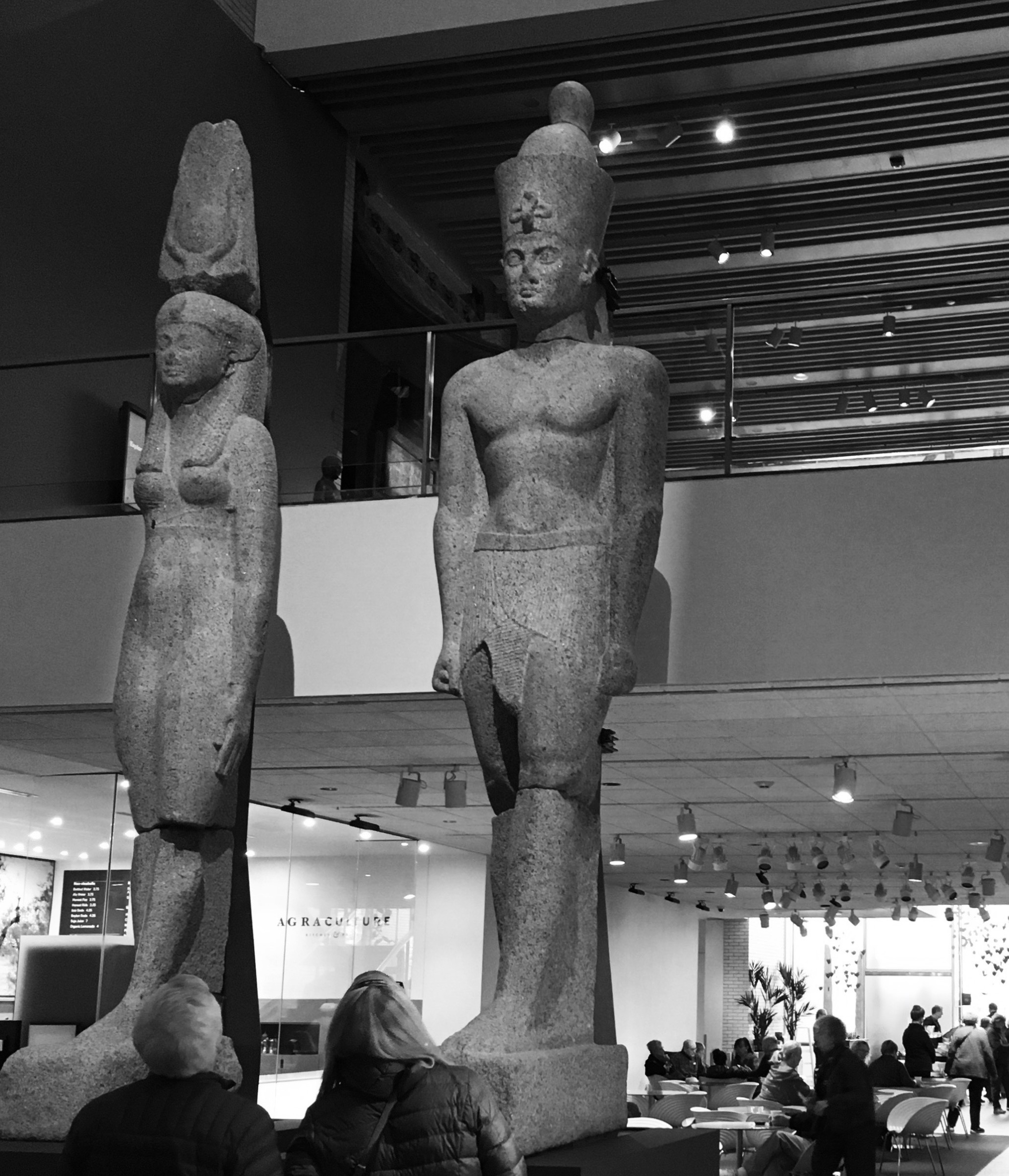 Colossi of Osiris and Isis standing roughly twenty feet tall in the foyer of the museum