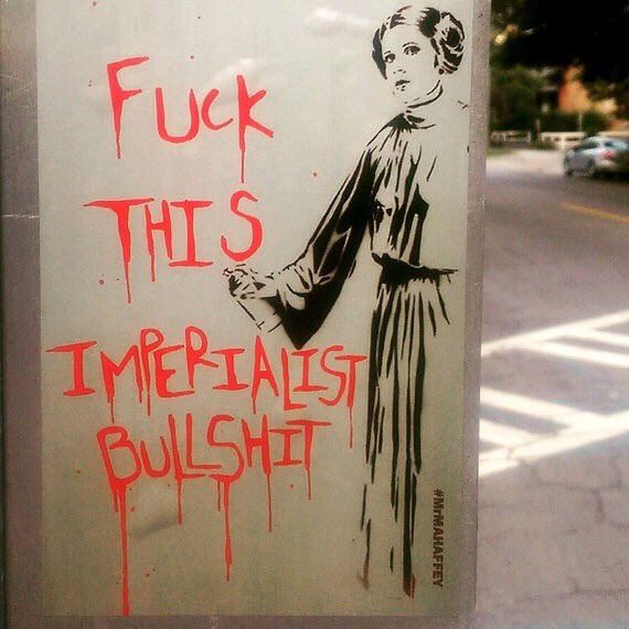 Princess Leia with a spray paint can, having just tagged a wall with the text: Fuck This Imperialist Bullshit