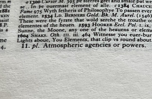 close-up of a dictionary definition, atmospheric agencies or powers