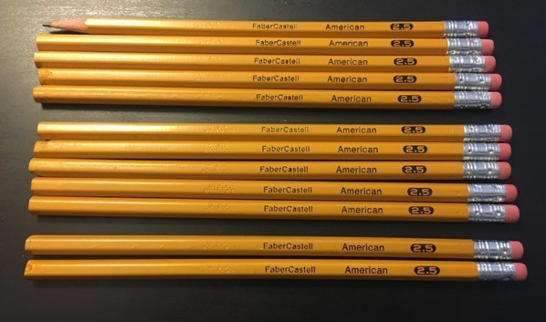 eleven unsharpened and one sharpened American 2.5 pencils