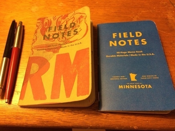 Field Notes Two Rivers and MN County Fair Blue Ribbon with two Parker Jotters nearby