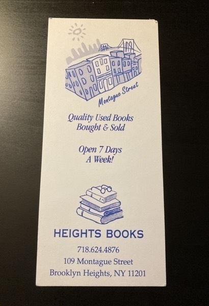 bookmark with a line drawing of the building with the Brooklyn Bridge in the background and another drawing of a stack of books